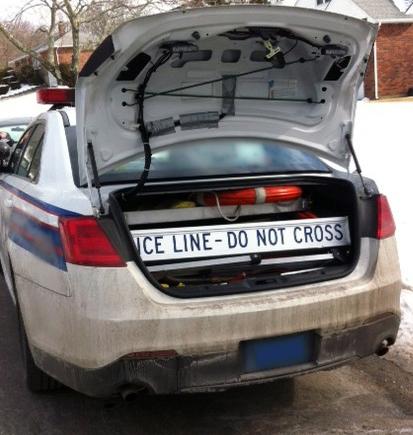 Retracta-Cade in Police Patrol Car Trunk